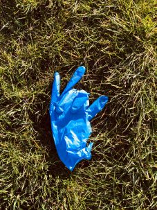 disposable glove in grass