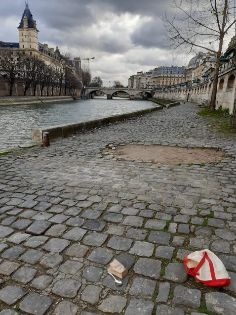 paper bag on sidewalk in paris