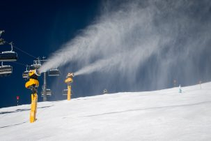 snow guns blowing out artificial snow