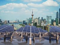 solar panels in front of shanghai skyline