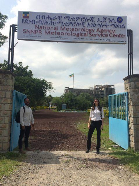 paulina concha larrauri and colleague stand outside a gate