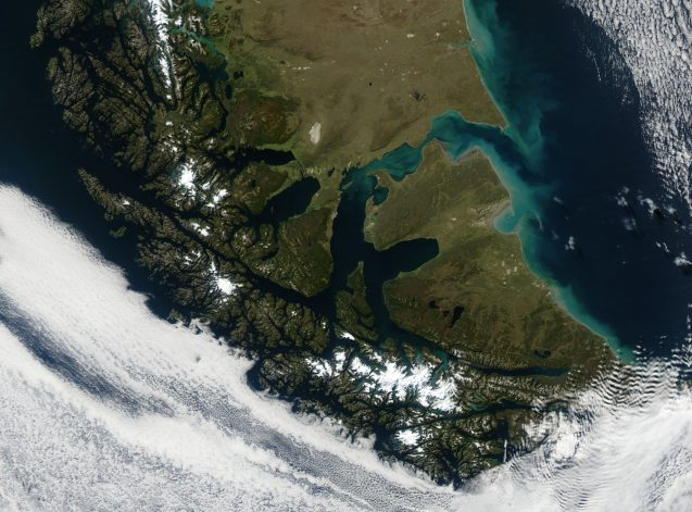 A space view of the land mass of southern Patagonia and Tierra del Fuego, marked by numerous narrow channels of water.