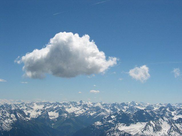 cumulous cloud over mountains