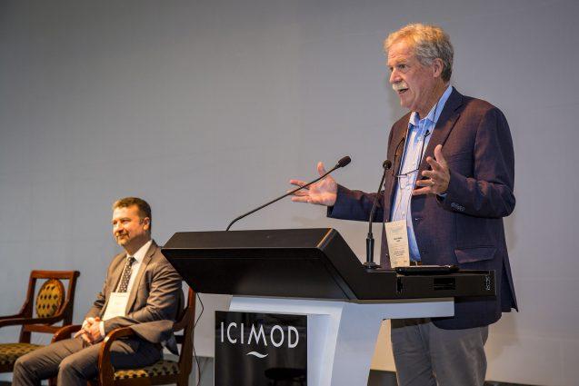 David Molden speaking at a podium