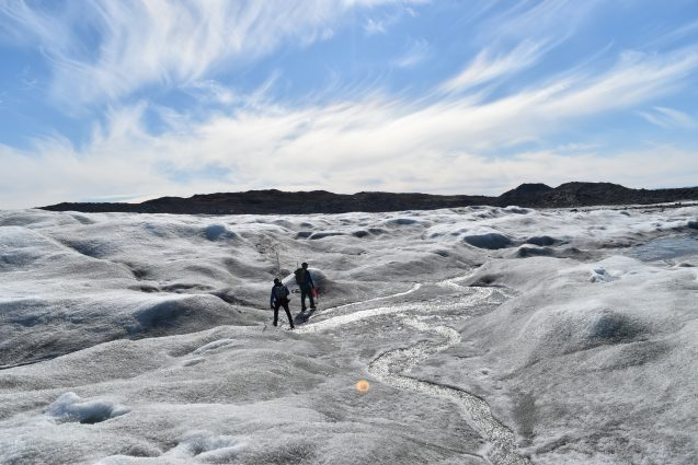 Researchers follow a meltwater stream in greenland