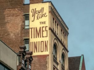 """A sign on a building in Albany, New York that reads, """"You'll like the Times Union"""""""