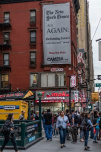 A photo of a billboard in New York protesting coverage by the New York Times of Middle East issues
