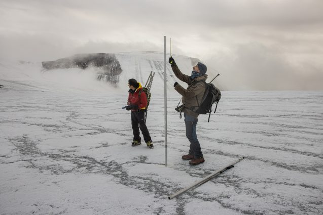 researchers gathering data on ice cap