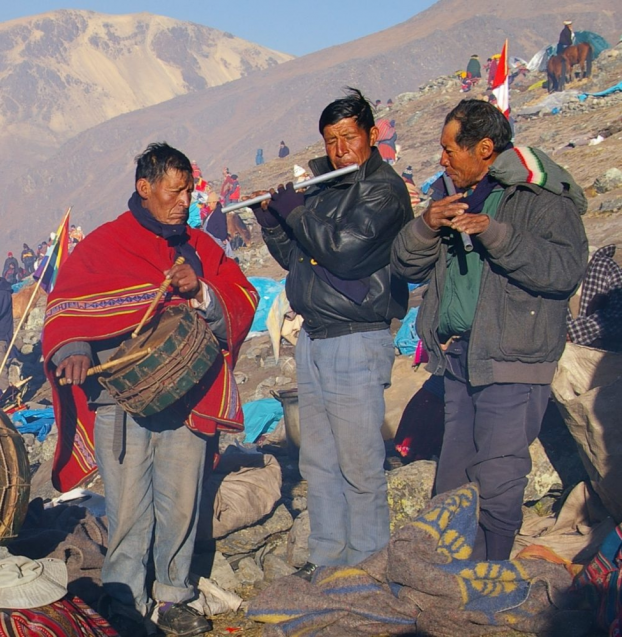 musicians on mountainside