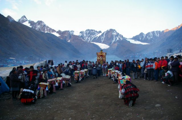 Pilgrims kneel at the Quyllurit'i shrine in the mountains