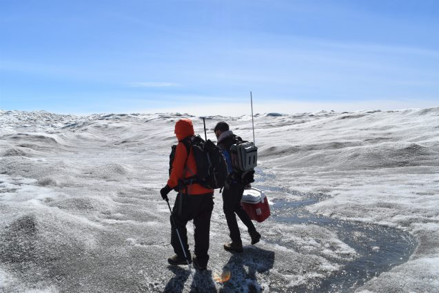 researchers walking on greenland ice sheet