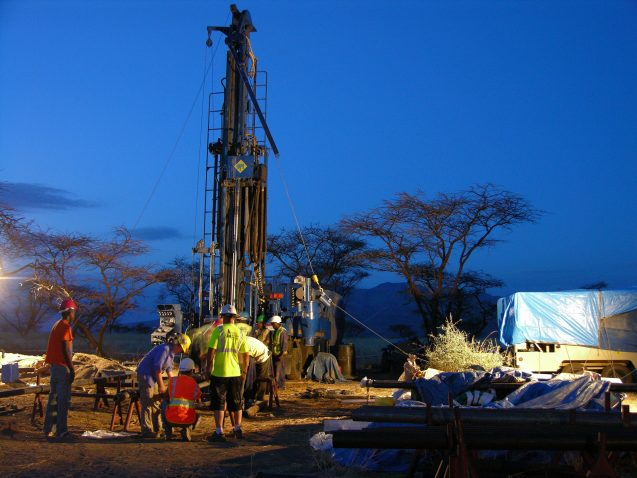 workers and drilling rig