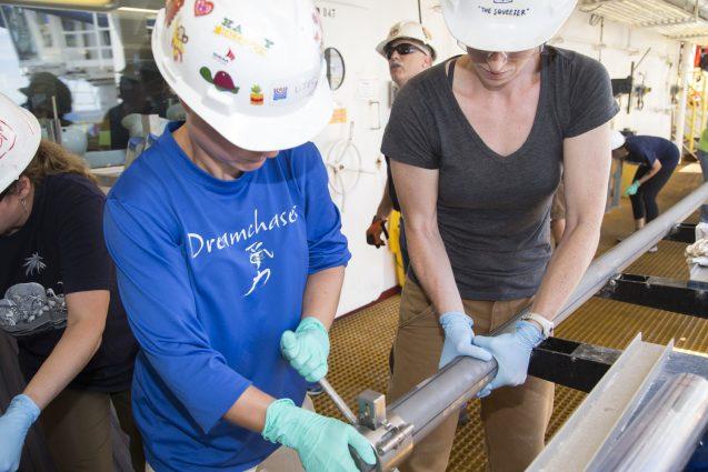 Researchers examine a sediment core