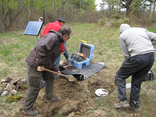 researchers burying equipment in the ground