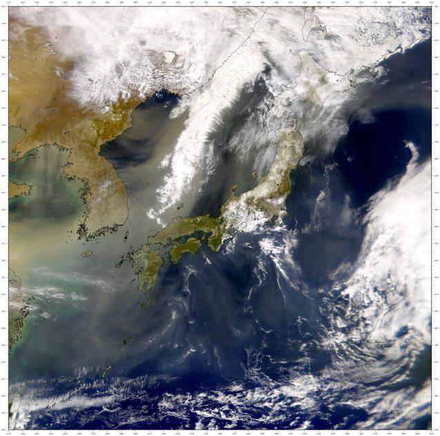 satellite image of dust blowing over pacific ocean