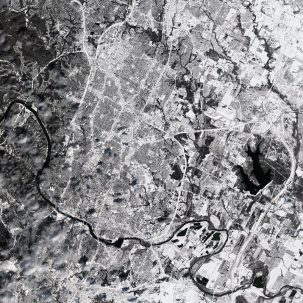 Satellite view of Austin, Texas, covered in snow