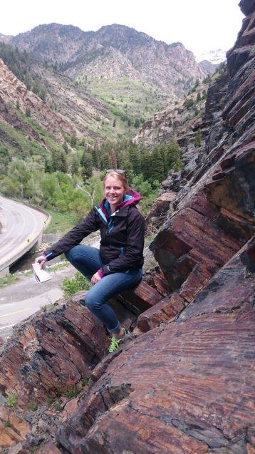 jacqueline austermann sitting on a rock outcrop