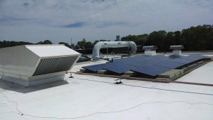 white rooftop with solar panels
