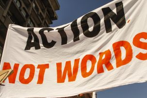 sign says 'action not words'
