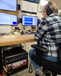person at desk listening for vocalizations