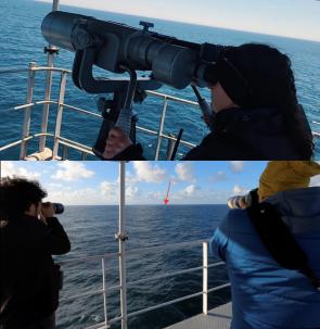 people looking through scopes and binoculars